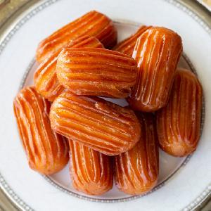 Słodkie i lepkie od syropu pączuszki z ciasta ptysiowego: przepis na tureckie TULUMBA TATLISI